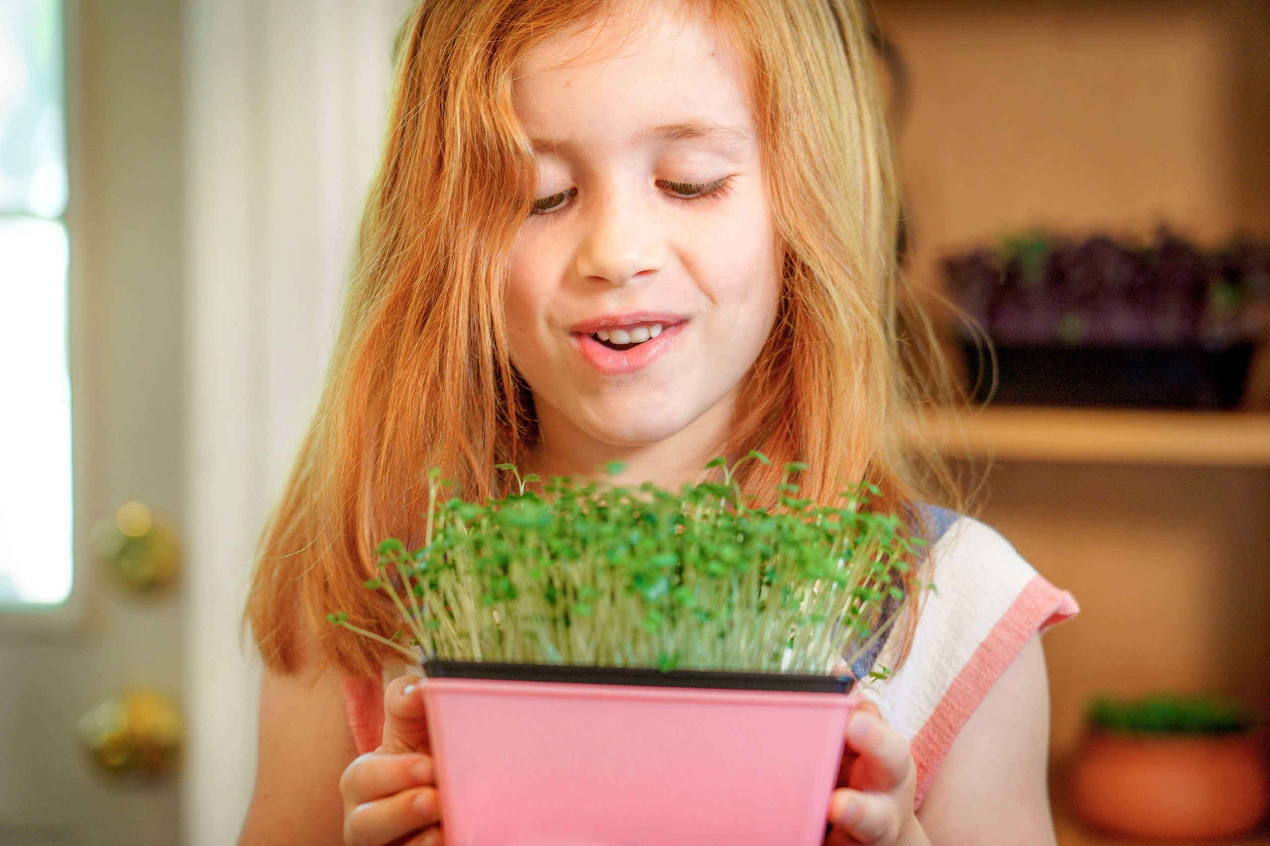 Young girl with microgreens- Autumn Payne, photogrpaher