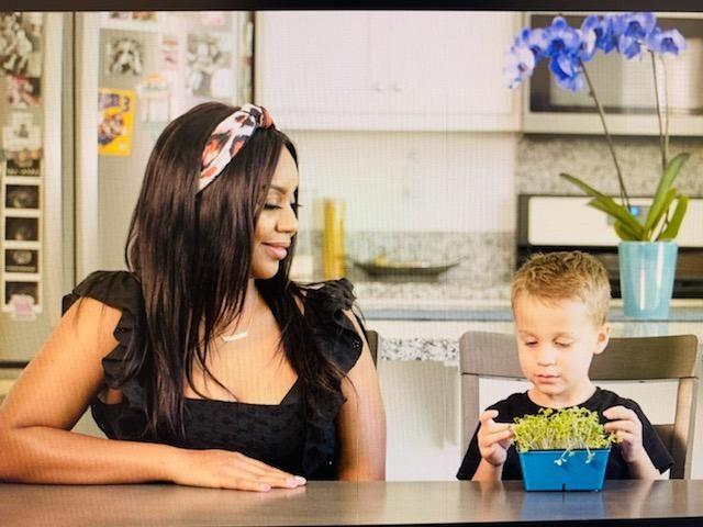 Mom and son with microgreens